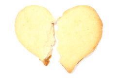 Valentine broken heart of yeast cake on white background Stock Photo