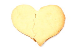 Valentine broken heart of yeast cake on white background Royalty Free Stock Image