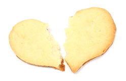 Valentine broken heart of yeast cake on white background Royalty Free Stock Photos