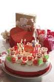 Valentine cake and gift parcels on table Stock Images