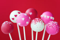 Valentine cake pops. Cake pops decorated with sugar hearts and sprinkles stock images