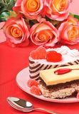 Valentine cakes, tarts and red roses on the red tablecloth Royalty Free Stock Photo
