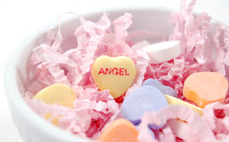 Valentine Candies. Multi-colored valentine candies in a dish with decor on a white background Stock Photos