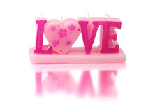 Valentine candle. Shaped as word Love stock images