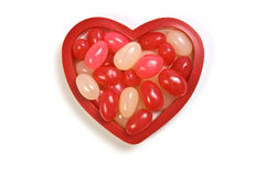 Valentine candy. Valentine jelly beans in heart shape on white background Royalty Free Stock Photography