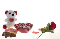 Valentine candy. In a heart shaped bowl with a stuffed bear isolated on white background stock images