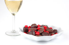 Valentine Candy. Plate of chocolates and candy hearts with a glass of champagne Stock Image