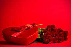 Valentine Candy Box and Roses on Red Background Stock Photography