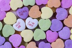 Valentine Candy Conversation Hearts. Colorful Valentine candy conversation hearts with message macro close up stock photography