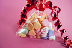 Valentine candy on pink background Royalty Free Stock Images