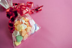 Valentine candy on pink background Stock Photo