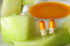 Valentine capsule in Honey dew. Capsule lovers in Honey dew melon Stock Photos