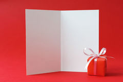 Valentine card. Blank white invitation card with a gift box Stock Photo