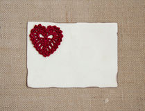 Valentine card with crochet heart Royalty Free Stock Photography