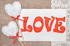 Valentine card with drawing word love on lace Royalty Free Stock Images