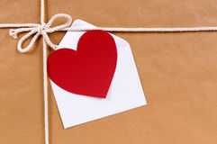Valentine card or gift tag, brown paper package or parcel, copy. Valentine card or gift tag, brown paper package or parcel Stock Image