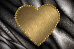 Valentine card with golden heart Stock Photography