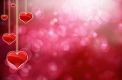 Valentine card with hanging hearts Stock Images