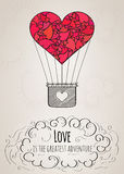 Valentine card with a heart-shaped hot air balloon and a love slogan Royalty Free Stock Photography