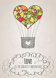 Valentine card with a heart-shaped hot air balloon and a love slogan Stock Photo