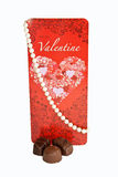Valentine Card with Pearls Isolated. A Valentine's Day card with a strand of cultured pearls and chocolate isolated on a white background royalty free stock photography
