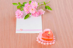 Valentine card of pink heart shaped candle and bouquet rose flow Stock Photography