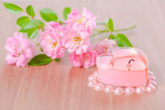 Valentine card of pink heart shaped candle framed pearl beads an Royalty Free Stock Photos