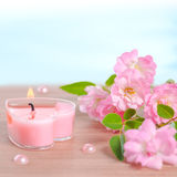 Valentine card of pink heart shaped candle, pearl beads and bouq Stock Images
