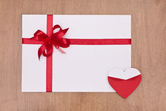 Valentine card with red ribbon and red heart Royalty Free Stock Image