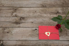 Valentines card and red rose on rustic wooden background Stock Photos