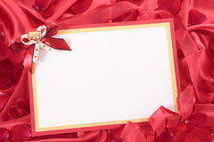 Valentine card. With ribbon and rose petals Royalty Free Stock Photo