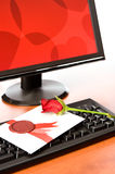 Valentine card with rose on keyboard Stock Images