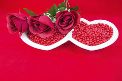 Valentine card roses red candy heart dish love concept Stock Photography