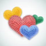 Valentine card. Several multi-colored fluffy hearts. Stock Photos