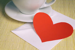 Valentine card on table with envelope and cup of coffee Royalty Free Stock Photo