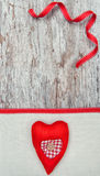 Valentine card with textile heart on canvas Royalty Free Stock Image