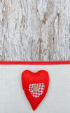 Valentine card with textile heart on canvas Stock Images