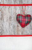 Valentine card with textile heart on canvas and old wood Royalty Free Stock Images