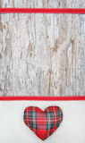 Valentine card with textile heart on canvas and old wood Royalty Free Stock Photography