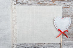 Valentine card with textile heart and linen fabric Royalty Free Stock Images