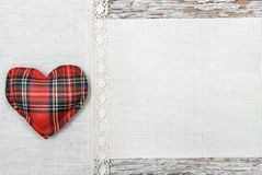 Valentine card with textile heart and linen fabric Royalty Free Stock Photos