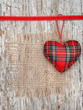 Valentine card with textile heart and sacking on old wood Stock Images