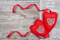 Valentine card with textile hearts on lace and old wood Stock Photography