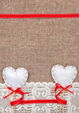 Valentine card with textile hearts and lacy cloth Royalty Free Stock Image