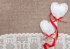 Valentine card with textile hearts and lacy cloth Stock Photo