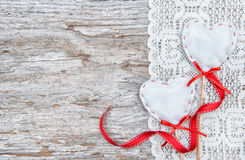 Valentine card with textile hearts on lacy cloth and old wood Royalty Free Stock Photos