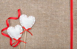 Valentine card with textile hearts and ribbon Royalty Free Stock Photos