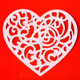 Valentine carving heart on the red paper background Royalty Free Stock Image
