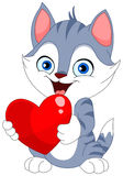 Valentine cat. Smiley cat holding a heart Stock Image