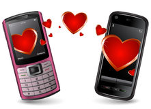 Valentine Cell Phones sending and recieving SMS Stock Photography